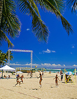 Teams of women actively compete in volleyball matches on the beach near Waikiki,Oahu.