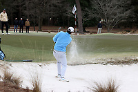 PINEHURST, NC - MARCH 02: Ryan Burnett of the University of North Carolina chips out of a bunker and onto the green on the 17th hole at Pinehurst No. 2 on March 02, 2021 in Pinehurst, North Carolina.