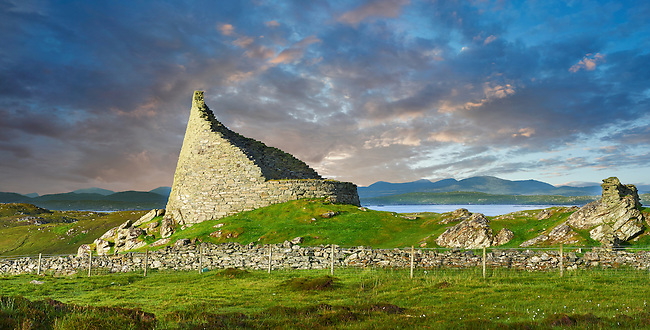 Pictures of Dun Carloway Broch on the Isle of Lewis in the Outer Hebrides, Scotland. Brochs are among Scotland's most impressive prehistoric buildings and were the precursors of the Medieval Scottish Tower Houses. The world Broch is derived from lowland scots who called forts Brough from the old Norse Borg. <br /> <br /> Broch stone roundhouses date from about 2,300 to 1,900 years ago, and are found mainly in north and west Scotland. Dun Carloway Broch was probably built around the time of the Roman occupation in Britain in 43AD and was probably the primary dwelling-places for the principal family in the area. Dun Carloway Broch would have provided some protection against sporadic raiding, but were not purely defensive structure but a focal point for the clan of the area.