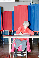 Ballot inspectors Joyce Soucy waits to check in voters as Merrimack Ward 1 Primary Voting begins at James Mastricola Upper Elementary School in Merrimack, New Hampshire, on Tue., Feb. 11, 2020. This is Soucy's first year working on an election.