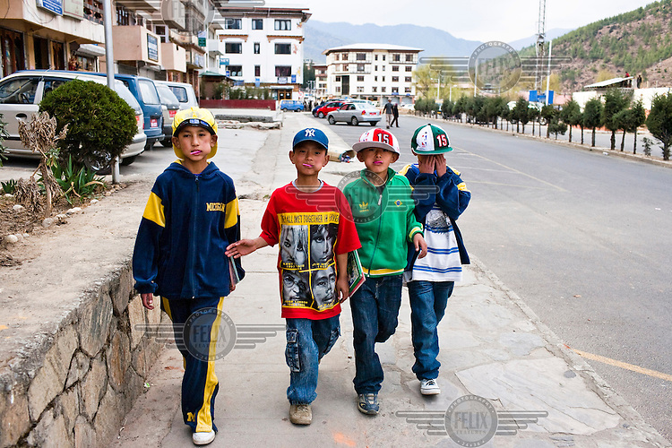 The traditional Bhutanese outfit, Gho, is mandatory for Bhutanese men, a move made in fear of influence from western culture. Yet these young children walk around in hip-hop clothes in the capital Thimpu, Bhutan.