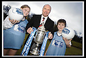 24/02/2009  Copyright Pic: James Stewart.File Name : sct_jspa02_scottis_cup.FORMER FALKIRK LEGEND ALEX TOTTEN SHOWS OFF THE HOMECOMING SCOTLAND SCOTTISH CUP TO SARAH JOHNSTON AND IAN MCARTHUR, PRIMARY SEVEN PUPILS AT ST MARGARET'S PRIMARY SCHOOL, POLMONT......Press Release..... A unique interactive tour to engage primary school children with football and the Homecoming Scottish Cup rolls into town today, Tuesday 24 February 2009 at St Margaret's Primary School in Falkirk.  . .Up to 100 pupils in primaries 5 to 7 at each local school will receive specialist skills and drill training from Scottish Football Association coaches as well as getting the chance to view the Homecoming Scottish Cup trophy itself.. .The school tour takes the form of a giant 'football-shaped' tent, which houses the world's oldest footballing trophy and information about Homecoming Scotland and the Scottish Cup tournament.. .Future football stars will be given soccer skills training ahead of watching their home team, Falkirk, take on Inverness Caledonian Thistle in the quarter finals of the Homecoming Scottish Cup on the weekend of 7 March.. .Falkirk legend Alex Totten, who used to manage the side, will be on hand at St Margaret's Primary School to share his knowledge and experience with the kids and to see the trophy himself.. .All primary schools in Scotland will also be sent education packs to encourage pupils to know more about Homecoming Scotland and to learn more about healthy eating, fitness and playing football as a way to keep fit and have fun.  . .As part of the football celebrations, the tour will then encourage locals in the town centre to get behind their local team, when the cup visits The Mall in Falkirk later in the afternoon.. .The Homecoming Scottish Cup Tour has been designed to engage with Scotland's local communities and spread the message about joining in the celebrations for Homecoming Scotland 2009, a programme comprising over 300 events to celebrate Scotland's culture, h