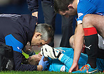 Rangers v St Johnstone....28.10.14   Scottish League Cup Quarter Final at Ibrox<br /> Steve Simonsen is treated after colliding with the post saving Brian Graham's header. He appears to have a nasty dent on his forehead<br /> Picture by Graeme Hart.<br /> Copyright Perthshire Picture Agency<br /> Tel: 01738 623350  Mobile: 07990 594431