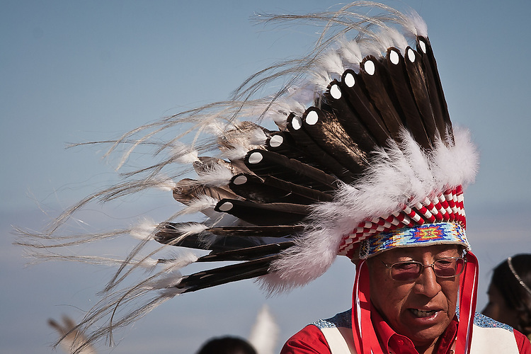 Man in a headdress braves the wind.