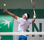 Marinko Matosevic (AUS) loses the first two sets against Andy Murray (GBR) at  Roland Garros being played at Stade Roland Garros in Paris, France on May 29, 2014