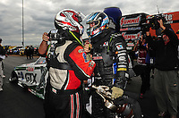 Sept. 18, 2011; Concord, NC, USA: NHRA funny car driver Matt Hagan (right) is congratulated by Mike Neff after winning the O'Reilly Auto Parts Nationals at zMax Dragway. Mandatory Credit: Mark J. Rebilas-