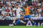 Geoffrey Kondogbia (r) of Valencia CF fights for the ball with Daniel Carvajal Ramos of Real Madrid during their La Liga 2017-18 match between Real Madrid and Valencia CF at the Estadio Santiago Bernabeu on 27 August 2017 in Madrid, Spain. Photo by Diego Gonzalez / Power Sport Images