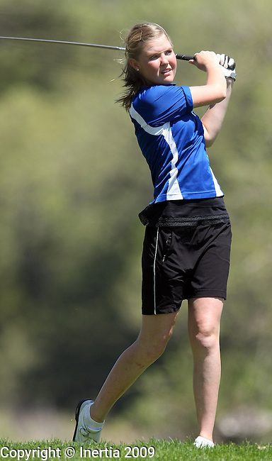 SIOUX FALLS, SD - MAY 19:  Molly Rezich of Rapid City Stevens watches her tee shot on the 13th hole during the final round of the Girls Class AA State Golf Championship Tuesday at the Brandon Golf Course in Brandon. (Photo by Dave Eggen/Inertia).