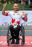 TORONTO, ON, AUGUST 8, 2015. Canadian Mark Ledo wins gold in Men's Road Race (H3-5) at the ParaPan Am Games in Toronto.<br /> Photo: Dan Galbraith/Canadian Paralympic Committee