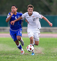 Marc Pelosi (11) of the United States sprints past Jose Villavicencio (5) of El Salvador during the quarterfinals of the CONCACAF Men's Under 17 Championship at Catherine Hall Stadium in Montego Bay, Jamaica. The USA defeated El Salvador, 3-2, in overtime.