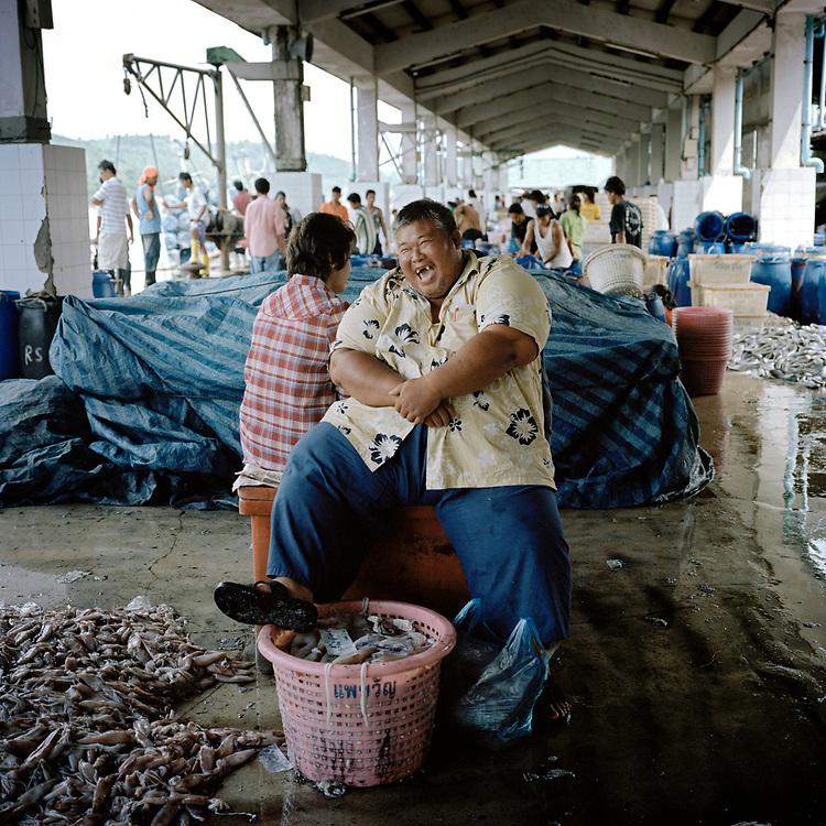 © 2021 John Angerson.<br /> Ranong fish trader, Thailand.