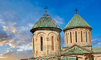 Pictures & images of the central cupolas of Gelati Georgian Orthodox churches of St George, 13th century in foreground and Church of the Virgin, 1106 behind. The medieval Gelati monastic complex near Kutaisi in the Imereti region of western Georgia (country). A UNESCO World Heritage Site. Heritage Site.