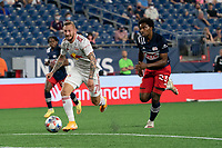 FOXBOROUGH, MA - MAY 22: Thomas Edwards #7 of New York Red Bulls approaches the New England Revolution goal with Jen Bell #22 of New England Revolution in pursuit during a game between New York Red Bulls and New England Revolution at Gillette Stadium on May 22, 2021 in Foxborough, Massachusetts.