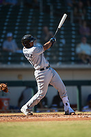 Peoria Javelinas catcher Ronaldo Hernandez (10), of the Tampa Bay Rays organization, follows through on his swing during an Arizona Fall League game against the Mesa Solar Sox at Sloan Park on November 6, 2018 in Mesa, Arizona. Mesa defeated Peoria 7-5 . (Zachary Lucy/Four Seam Images)