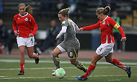 Amy Rodriguez (8) of the Philadelphia Independence turns past Cat Whitehill (4) of the Washington Freedom as Allie Long (9) looks on.  Philadelphia defeated Washington 3-1, in their first win of the season at John A. Farrell Stadium in West Chester, PA.