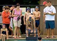 Young swimmers  compete in local swimming competition in Charlotte NC. The pre-teen athlete is participating in a summer swim program hosted by his local YMCA.