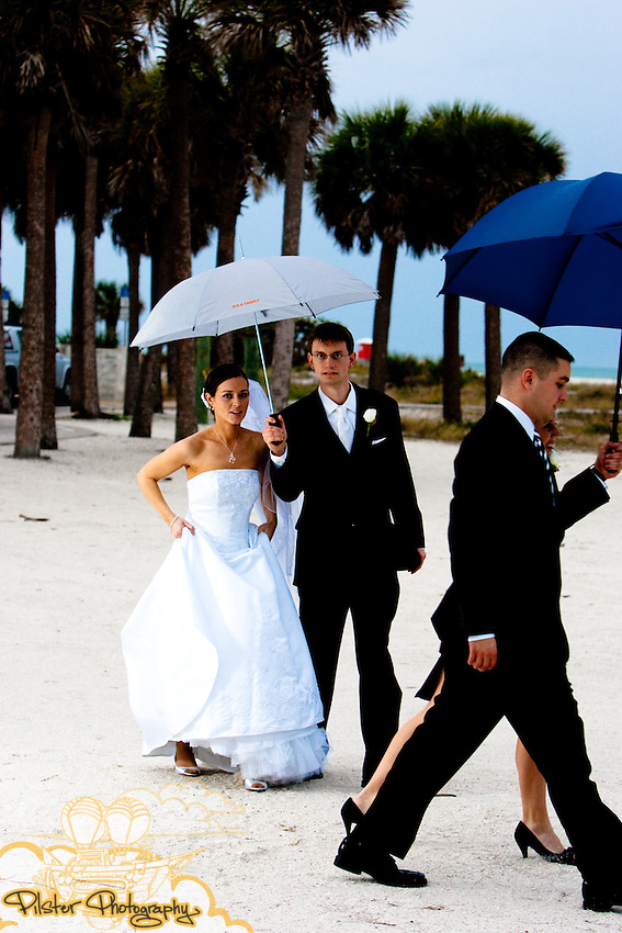 The wedding of Andrew Pierson and Kim Haire on Saturday, January 16, 2010, at Sand Key Park, Clearwater, Florida. Kim started at the Holiday Inn Harbourside Marina, had makeup done at The Spa at Salon West, in Largo, returned to the hotel and then headed to a portrait session at the Gulf Coast Museum of Art at the Pinewood Cultural Park, in Largo. After that it was time to head to Christ of the King Church, then Sand Key Park for more photos and finish the night up at Shepherd's Beach Resort in Clearwater.     (Chad Pilster, http://www.PilsterPhotography.net)