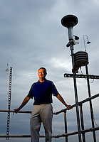 Mecklenburg County Air Monitoring Environmental Specialist David Hord at the Garinger High School monitor station in Charlotte, North Carolina.<br />
