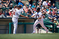 Rochester Red Wings manager Joel Skinner (35) congratulates LaMonte Wade Jr (4) after hitting a home run during an International League game against the Scranton/Wilkes-Barre RailRiders on June 25, 2019 at Frontier Field in Rochester, New York.  Rochester defeated Scranton 10-9.  (Mike Janes/Four Seam Images)