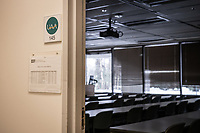 A classroom with a full course schedule for the spring semester sits empty as spring break is extended and UAA classes transition to distance learning for the remainder of the semester in response to the spread of COVID-19