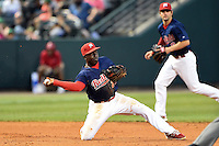 Memphis Redbirds third baseman Jermaine Curtis (23) throws to second with shortstop Pete Kozma (8) backing up the play during a game against the Oklahoma City RedHawks on May 23, 2014 at AutoZone Park in Memphis, Tennessee.  Oklahoma City defeated Memphis 12-10.  (Mike Janes/Four Seam Images)