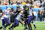 Washington Huskies linebacker Cory Littleton (42) in action during the Zaxby's Heart of Dallas Bowl game between the Washington Huskies and the Southern Miss Golden Eagles at the Cotton Bowl Stadium in Dallas, Texas. Washington defeats Southern Miss 44 to 31.