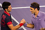 SHANGHAI, CHINA - OCTOBER 16: Novak Djokovic of Serbia congratulates Roger Federer of Switzerland at the end of their match during day six of the 2010 Shanghai Rolex Masters at the Shanghai Qi Zhong Tennis Center on October 16, 2010 in Shanghai, China.  (Photo by Victor Fraile/The Power of Sport Images) *** Local Caption *** Roger Federer; Novak Djokovic