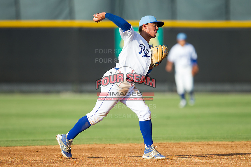 Burlington Royals shortstop Marten Gasparini (44) makes a throw to first base against the Greeneville Astros at Burlington Athletic Park on June 29, 2014 in Burlington, North Carolina.  The Royals defeated the Astros 11-0. (Brian Westerholt/Four Seam Images)