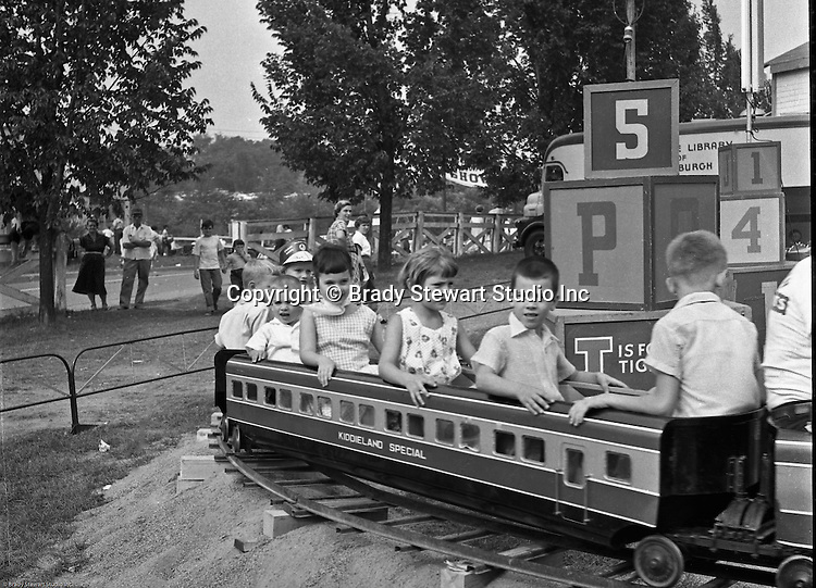 West Mifflin PA:  View of the Kiddieland Express train at Kennywood Park. The Stewart family visited Kennywood during the summer of 1956. Kennywood Park is one of the oldest amusement parks in America, founded in 1898. Kennywood Park was a big part of our childhood in the Pittsburgh area. At the end of each school year, most school districts had a Kennywood Park Day.  The rides included the roller coasters; Jackrabbit, Racer, and Thunderbolt along with the infamous Old Mill where you could steal a kiss or two.  Kennywood was designated a National Historic Landmark since 1987