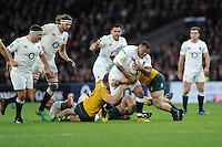 Kyle Sinckler of England is tackled by Michael Hooper and David Pocock of Australia during the Old Mutual Wealth Series match between England and Australia at Twickenham Stadium on Saturday 3rd December 2016 (Photo by Rob Munro)