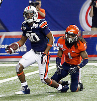 ATLANTA, GA - DECEMBER 31: Emory Blake #80 of the Auburn Tigers is tackled by Demetrious Nicholson #1 of the Virginia Cavaliers during the 2011 Chick Fil-A Bowl at the Georgia Dome on December 31, 2011 in Atlanta, Georgia. Auburn defeated Virginia 43-24. (Photo by Andrew Shurtleff/Getty Images) *** Local Caption *** Demetrious Nicholson;Emory Blake