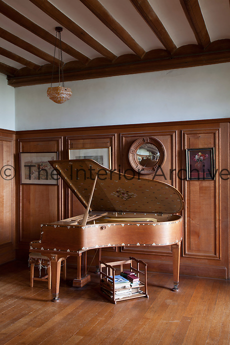 A piano designed by the cabinet maker Peter Waals. The decoration was undertaken by Louise Powell, who's husband Alfred designed the panelling
