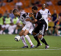 Barry Rice (15) of D.C. United stays close to Alvaro Saborio (15) of Real Salt Lake during a U.S. Open Cup tournament game at RFK Stadium in Washington, DC.  D.C. United defeated Real Salt Lake, 2-1, in overtime.