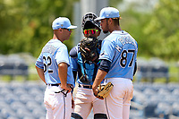 FCL Rays pitching coach Alberto Bastardo (62) talks with pitcher Matthew Peguero (87) and catcher Mario Fernandez (59) during a game against the FCL Twins on July 20, 2021 at Charlotte Sports Park in Port Charlotte, Florida.  (Mike Janes/Four Seam Images)