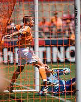 Houston Dynamo defender Wade Barrett (24) helps out Houston Dynamo goalkeeper Pat Onstad (18).  The Houston Dynamo tied  FC Dallas 3-3 at Robertson Stadium in Houston, TX on April 6, 2008.