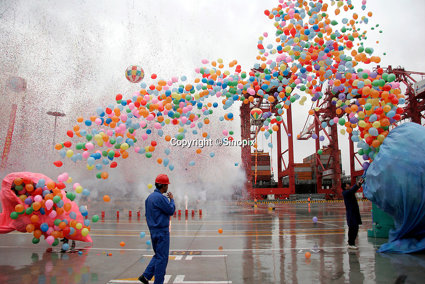 Workers release balloons and confetti during the opening ceremony of the Yangshan Deep Water Port in Shanghai, China. The port will give the city it's first deep water port, adding capacity to its formidable shipping infrastructure,  already Shanghai is expected to become world's largest freight port at the end of this year surpassing Singapore, according to materials provided by the Ministry of Commerce..