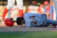 Williamsport Crosscutters outfielder Gustavo Martinez #24 on the ground after getting hit by a foul ball off his ankle during a game against the Jamestown Jammers on June 20, 2013 at Russell Diethrick Park in Jamestown, New York.  Jamestown defeated Williamsport 12-6.  (Mike Janes/Four Seam Images)