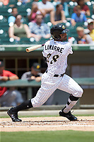 Ryan LaMarre (28) of the Charlotte Knights follows through on his swing against the Indianapolis Indians at BB&T BallPark on August 22, 2018 in Charlotte, North Carolina.  The Indians defeated the Knights 6-4 in 11 innings.  (Brian Westerholt/Four Seam Images)