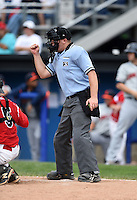 Umpire Matt Carlyon makes a call during the first game of a doubleheader between the Connecticut Tigers and Batavia Muckdogs on July 20, 2014 at Dwyer Stadium in Batavia, New York.  Connecticut defeated Batavia 5-3.  (Mike Janes/Four Seam Images)