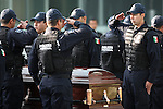 Mexican Federal Police officers pay their respects to Edgar Millan, a top federal police officer killed by alledged drug traffickers in his Mexico City's home on May 8, 2008. Millan led important anti-drug and anti-kidnapping operations during the last years. Photo by Heriberto Rodriguez