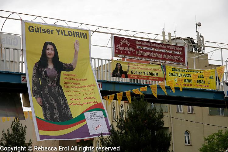 Election posters in Turkish, Kurdish, Arabic and Assyrian for independent female candidate Gulser Yildirim in Midyat, Southeastern Turkey