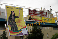 Election posters in Turkish, Kurdish, Arabic and Assyrian for independent female candidate Gulser Yildirim in Midyat, Southeastern Turkey