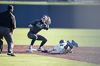 Michigan State shortstop Mitch Jebb (41) waits for a throw as Michigan Wolverines baserunner Christian Bullock (5) slides into second base during a steal attempt on March 21, 2021 in NCAA baseball action at Ray Fisher Stadium in Ann Arbor, Michigan. Michigan scored 8 runs in the bottom of the ninth inning to defeat the Spartans 8-7. (Andrew Woolley/Four Seam Images)