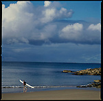 A surfer gets ready to go out a Manly with his surfski, Sydney, Australia.
