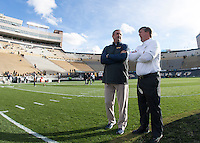 California head coach Sonny Dykes talks with Colorado head coach Mike MacIntyre before the game at Folsom Field in Boulder, Colorado on November 16th, 2013.  Colorado defeated California, 41-24.