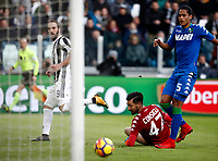 Calcio, Serie A: Juventus - Sassuolo, Torino, Allianz Stadium, 4 Febbraio 2018. <br /> Juventus' Gonzalo Higuain (l) scores his third goal in the match contrasted by  Sassuolo's goalkeeper Andrea Consigli (c) and Mauricio Lemos (r) during the Italian Serie A football match between Juventus and Sassuolo at Torino's Allianz stadium, February 4, 2018.<br /> UPDATE IMAGES PRESS/Isabella Bonotto