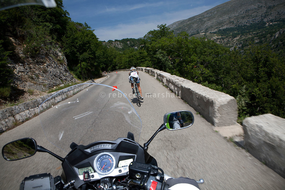 Triathlete Beth Walsh photographed from a press motorbike, Ironman France 2012, Nice, France, 24 June 2012