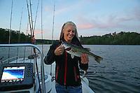 May 15, 2015; Commerce, GA, USA; NHRA pro stock motorcycle rider Angie Smith holds a spotted largemouth bass caught while fishing at Lake Lanier before the Southern Nationals at Atlanta Dragway. Mandatory Credit: Mark J. Rebilas-USA TODAY Sports
