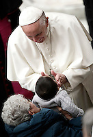 Papa Francesco accarezza un bambino al termine dell'udienza generale del mercoledi' in aula Paolo VI in Vaticano, 15 febbraio 2017.<br /> Pope Francis caresses a child at the end of his weekly general audience in Paul VI Hall at the Vatican, on February 15, 2017.<br /> UPDATE IMAGES PRESS/Isabella Bonotto<br /> <br /> STRICTLY ONLY FOR EDITORIAL USE