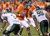 Oct 23, 2010; Charlottesville, VA, USA;  Virginia Cavaliers offensive tackle Matt Mihalik (71) prepares to block Eastern Michigan Eagles defensive end Kalonji Kashama (95) during the game at Scott Stadium.  Virginia won 48-21. Mandatory Credit: Andrew Shurtleff